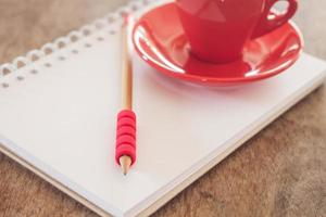 Notepad with a pencil and mug