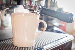 Coffee cup under an espresso machine