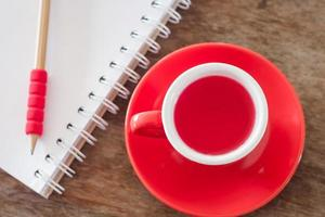 Top view of a red cup with a notebook