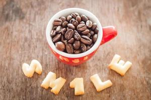 Smile alphabet biscuits with a red coffee cup