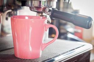 Pink coffee mug in coffee shop