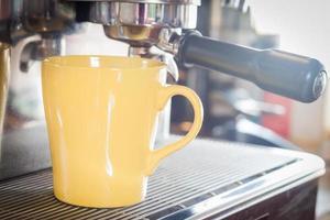 Yellow coffee mug in coffee shop