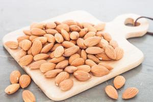 Almond nuts on a cutting board photo