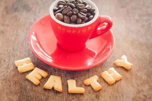Healthy alphabet biscuits with a red coffee mug