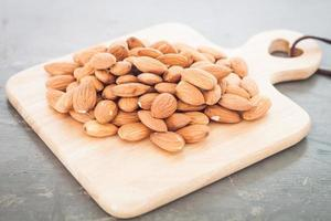 Almond nuts on a board photo