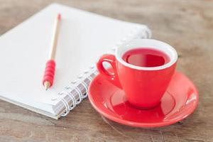 Red mug with a notebook