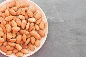 Almond nuts on a wooden plate photo