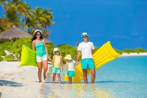 Family walking on a tropical beach