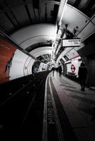 London, England 2018-Traveller's walk through an underground subway