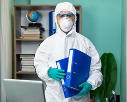 Person in protective suit at the office