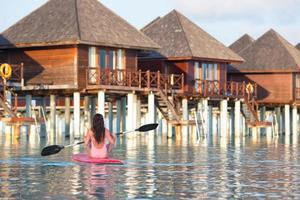 Woman paddleboarding at a resort