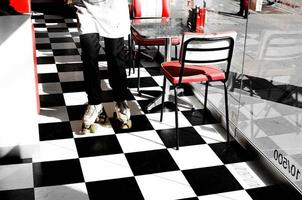 Melbourne, Australia, 2020 - Person wearing rollerblades on a checkered floor