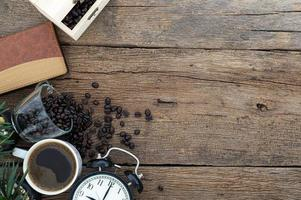 Office work tools and coffee on wooden table