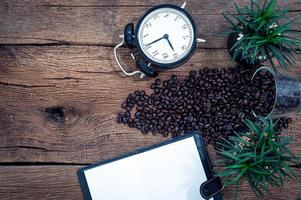 Coffee, notebook and alarm clock