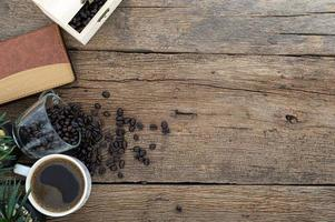 Wooden desk with coffee, top view
