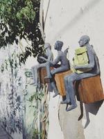 Tel Aviv-Yafo, Israel, 2020 - Three statues sitting on wooden blocks