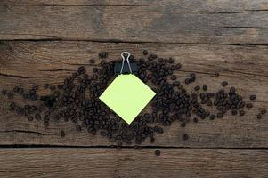 Wooden desk with coffee beans and note pad