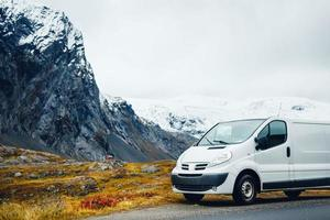 White van parked near mountains