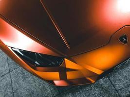 Kish Island, Iran, 2020 - Top view of an orange Lamborghini Aventador Coupe