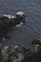 Aerial view of coastal rocks and water