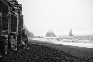 Grainy black and white photo of black sand beach