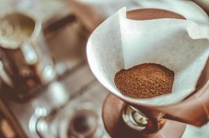 Brown coffee in a white strainer photo