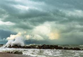 Waves splashing on a moody beach