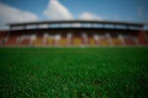Stadium background with a green grass pitch photo