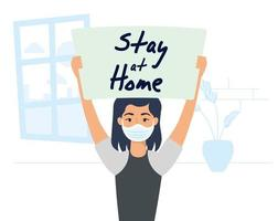 Woman holding a stay home sign