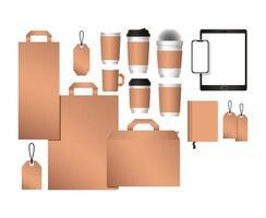 tableta de maqueta con diseño de bolsas de teléfono inteligente y tazas de café vector