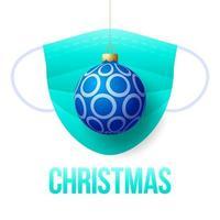 bola de navidad azul realista con mascarilla médica desechable