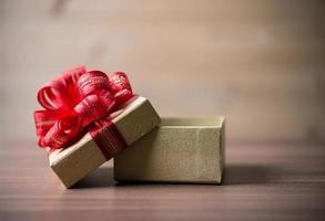 Small gift box on wooden background