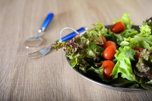 Fresh salad with vegetables and greens photo