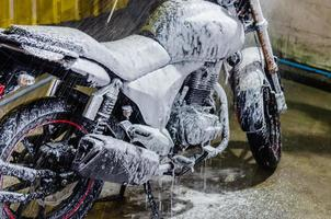 Motorcycle being cleaned