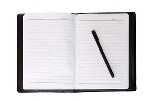 Top view of a notebook and pen