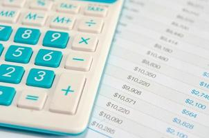 Close-up of a blue calculator and finances
