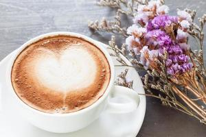 Close-up of a latte and flowers