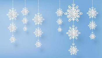 feliz navidad y temporada de invierno con copos de nieve cortados en papel