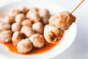 Pork meatballs dipped in sauce