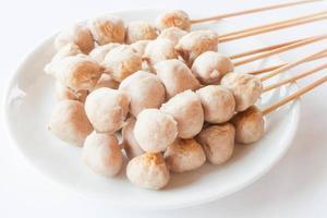 Skewers of pork meatballs photo