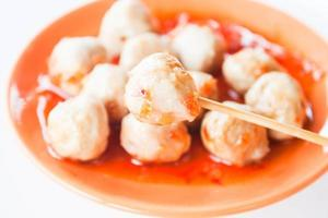 Pork meatballs in sauce on a plate photo