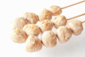 Pork meatballs on skewers on a white background photo