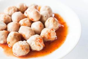 Close-up of meatballs in sauce photo