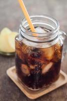 Cola in a glass jar