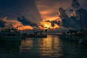 Boats on the harbor at sunset photo