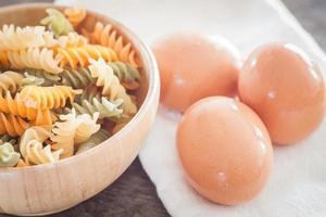 Fresh eggs on a cloth with fusili