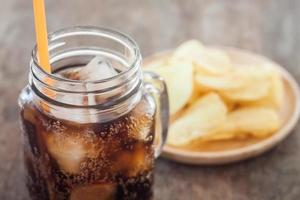 Glass jar of soda and chips