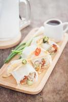 Spring rolls and sauce on a table