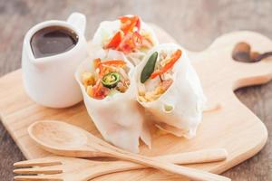 Fresh spring rolls on a wooden table