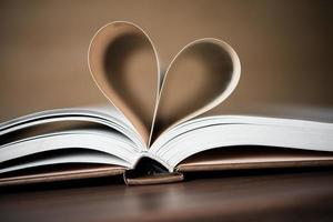 Pages of a book form the shape of the heart